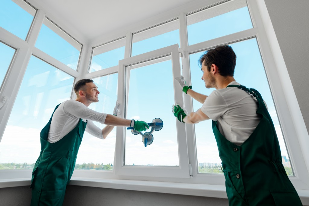 two workers doing window replacement
