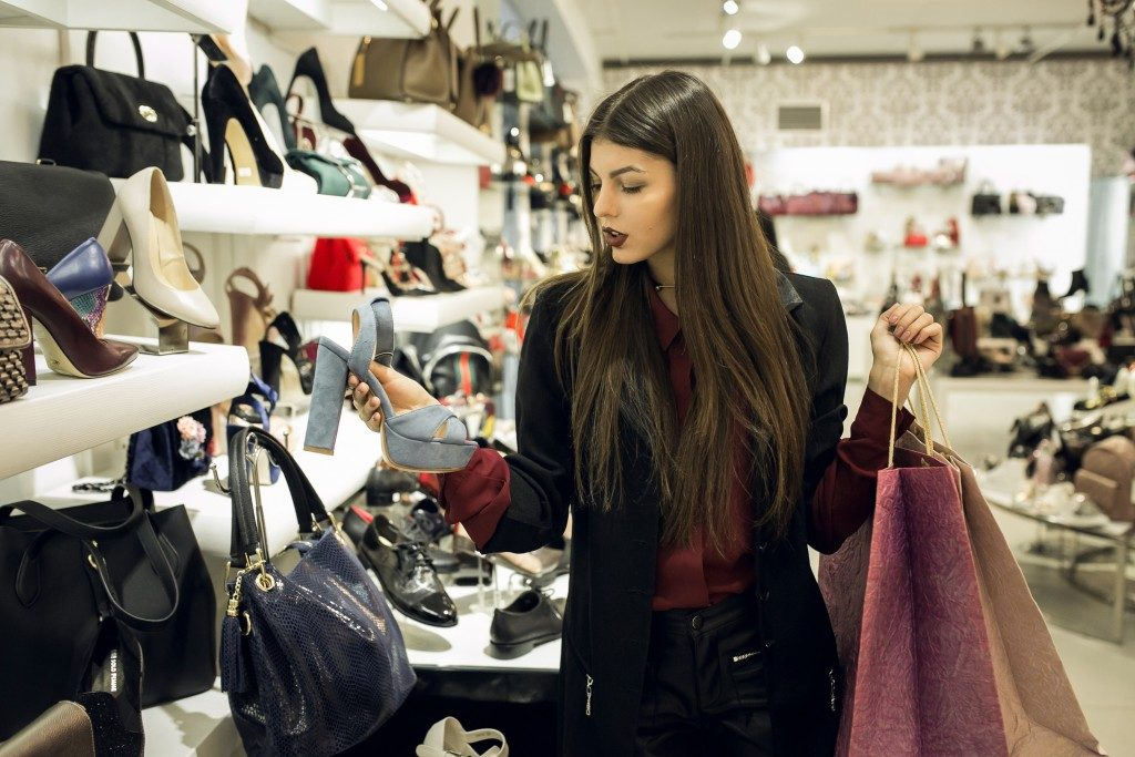 fashionable woman shopping for shoes