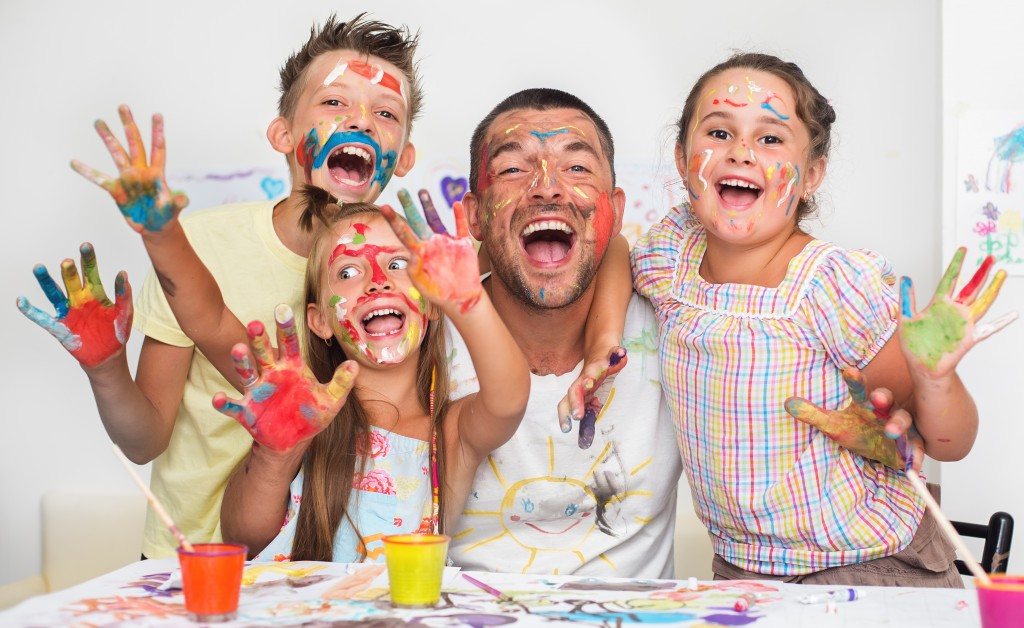 family playing with paint