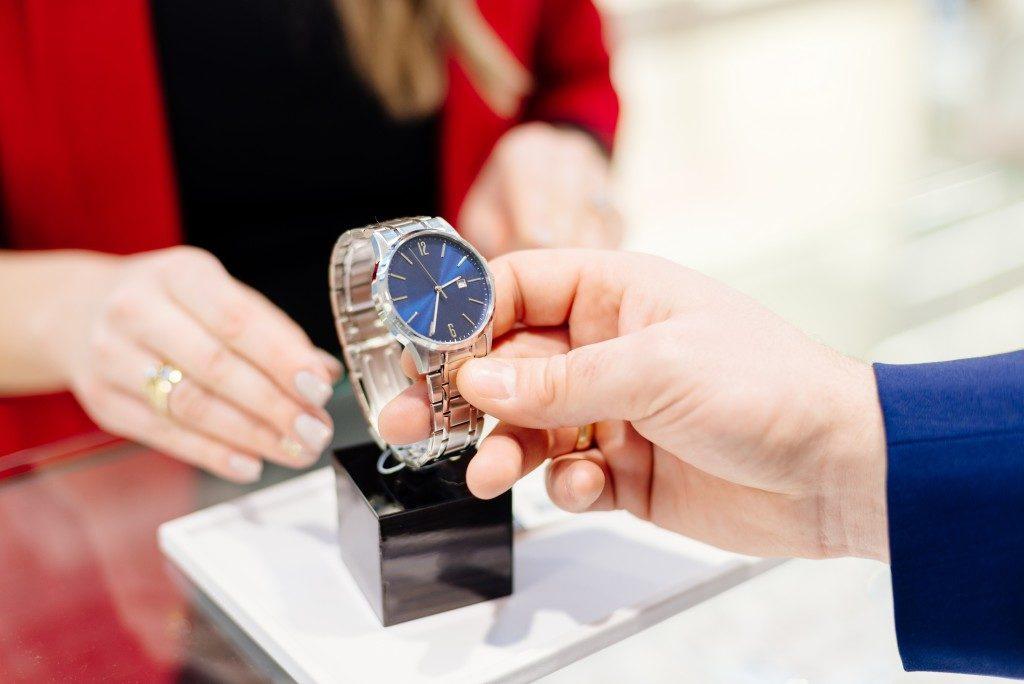 man buying watch