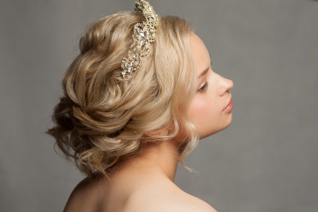Beautiful blond girl with a tiara in her hair