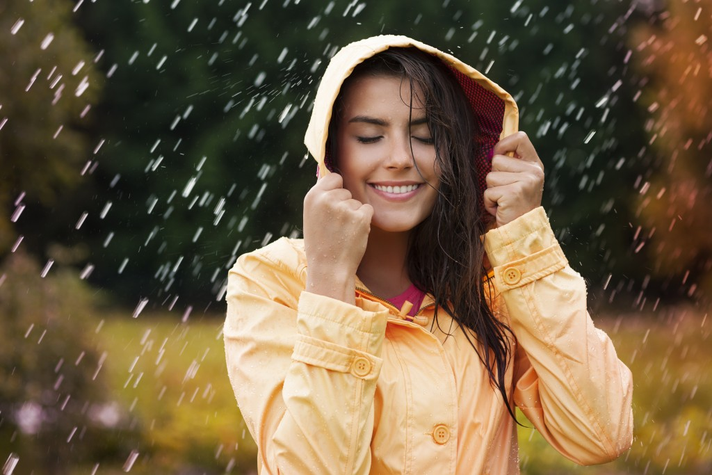 Beautiful girl under the rain