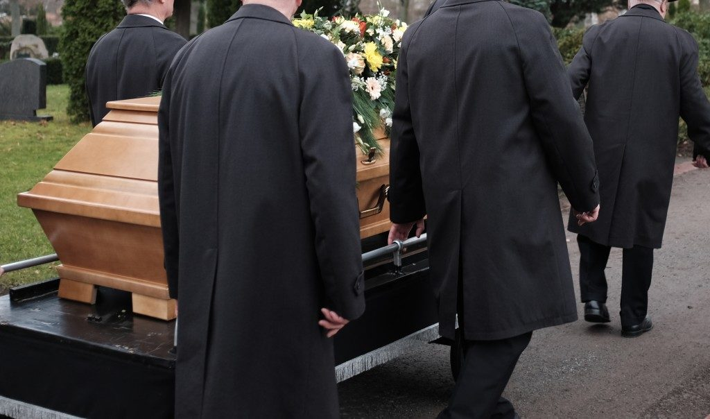 people dressed in black in the funeral
