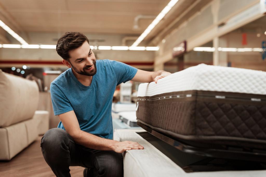 man buying a mattress