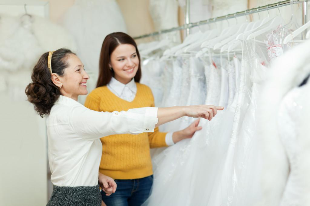 bride picking wedding gown