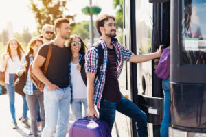 man boarding travel bus